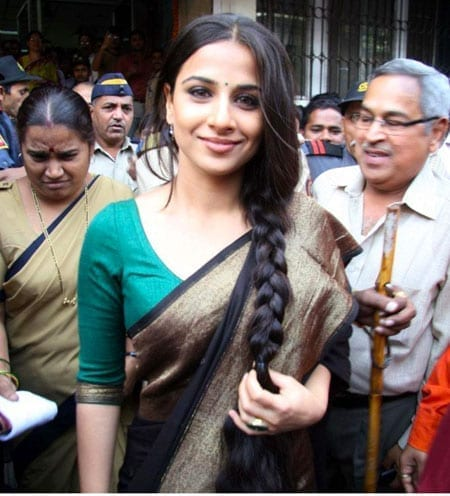 Vidya Balan is looking cheerful wearing saree